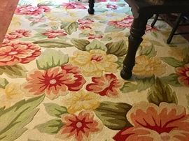 A second 10 x 6.5' wool hooked area rug