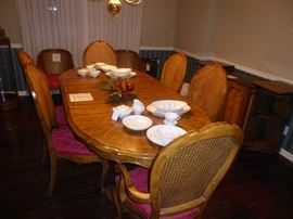 "BERNHARDT / HIBRITEN SET - TABLE- 6 CANE CHAIRS -THIS BEAUTIFUL SET IS MADE OF PECAN SOLIDS AND VENEERS. PEDESTAL TABLE- 42"" x 50"" WITH TWO 18"" LEAVES. INCLUDED TABLE PADS."