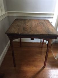 Antique folding wooden sewing table.
