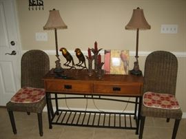 matching wicker chairs, designer lamps & table
