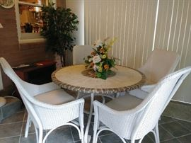 cute metal base patio table w/stone top and 4 outdoor wicker chairs
