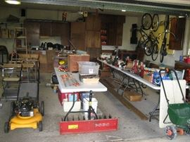 garage full of tools, outdoor equipment, bikes and more