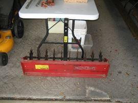 Pull behind mower aerator