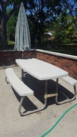 $100   Plastic picnic table with umbrella