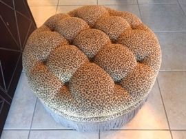 tufted leopard print and fringed ottoman