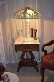 Large Gorgeous Leaded Glass Lamp. This lamp is Special! An Awesome Design with Original Leaded Glass. This Lamp is so Heavy that I can hardly pick it up with two hands unless I remove the Shade! And it sitting on a Beautiful Antique Marble Top Lyre Table with Carnival Glass Vases and More!