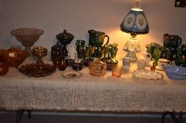 Just look at the Vintage Carnival Glass in this Picture featuring Carnival Glass Punch Bowl, Lidded Compote, Lidded Jar, Gorgeous Marigold Fruit Bowl and 2 Grape and Cable Pitcher Sets with different styling in each. Plus Gorgeous Hard to Find Porcelain Lamp (both Shade and Base are Porcelain)