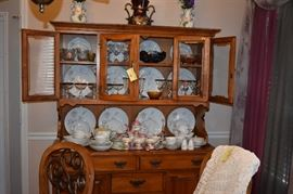 Beautiful Quality China Hutch with  a Gorgeous Display of China. The Hutch features Glass Doors, Pull Drawers, Plate Lines plus Cabinet Door Storage