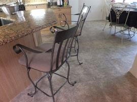 bar stools pair with padded seats