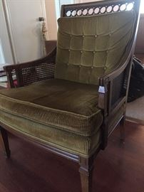 Green vintage chair with caned sides