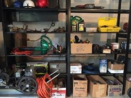 Shelves of garage stuff, including tools, compressor, supplies, helmets, and much more!
