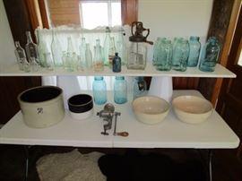 Antique bottles, some signed, Daisy butter churn, Ball canning jars, 2 gal butter crock, Stoneware shoulder bowls, Griswald meat grinder