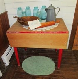 Drop leaf kitchen table w/ painted red legs, enamelware coffee pot, rolling pin, salad bowel, aqua Ball canning jars