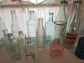 Signed antique alcohol, soda and medicine bottles