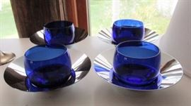 cobalt glass bowls on silver trays