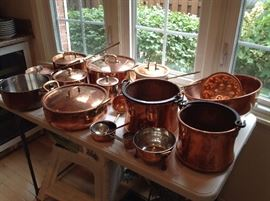 Many pieces of copper....pots and pans with copper lids, some are hammered older pieces, jello molds, ladles, bowls etc....some marked All Clad for brand...presale available
