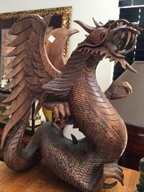 This large wood carved dragon is solid and heavy... and just in time to join you for a little Game of Thrones