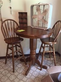 Oak pub table with 2 swivel chairs