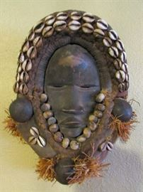 African lady's mask. Very intricate and was explained she was probably a person of honor. We have several African pieces in our collection.