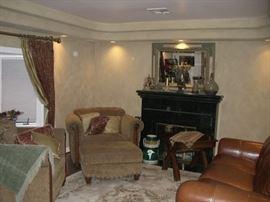 sofa chair; curtains and curtain rod;  rug;  mahogony side table;  decor items