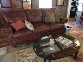 Leather sofa (sold), beautiful area rug (sold), drop leaf coffee table still available!