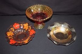 "Various Amber Glass Bowls: one pedestal bowl 6-1/2"" high with 9"" diameter accented with red; 10"" bowl with ruffle edges and 10"" scalloped bowl with hand painted red flowers and fall leaves. (1920-40's). This lot is in very good condition and shows little wear, if any"