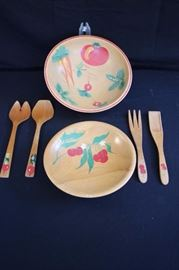 "Hand Painted Woodware Salad Set: including two sets of salad servers (10"" 11"") and one 9"" bowl for serving fruit hand painted with cherries and one 11"" bowl for serving salad hand painted with carrots, peas radishes and tomato. The set is in very good condition with no chips in the hand painted decoration or visible wear to the wooden bowls."