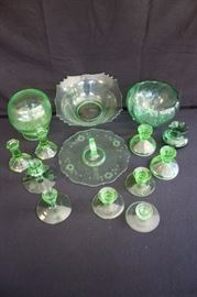 "14 item Green Depression Glass Set: including three pairs of candlesticks 4-1/2"", 4"" and 3"" and single candlesticks 1-1/2"", 3"" and 3-1/2""; 3 decorative and serving bowls 8"",  6"" and 10"" and 10"" finger sandwich serving platter with handle. (1929-1939)This lot is in very good vintage condition and shows little wear, if any.  - No chips, cracks, or deep scratching. As with all vintage items, some slight surface scratches can be seen on the tops of the plates from utensil use and some on the bottom from stacking and the glass is bright and clear. No staining or discoloration."