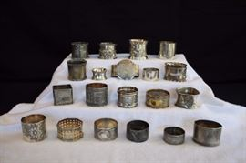 20-piece Victorian Napkin Ring Collection: (1840-1900) silver plated/electroplate and various metals 4 smaller and 16 average size. These are silverplated with some plate-through wear.All in good condition considering their age are very usable. Various shapes and sizes. No marks on inside, only marks on those with engraved design or initials and embossed decorations.