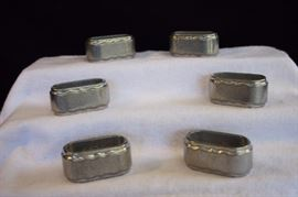 Six Armetale-like Napkin Rings by Pacific: 6 matching oval napkin rings marked Six matching 3.5' napkin rings marked with logos and PACIFIC Since 1929. In very good condition with no signs of wear and tear.