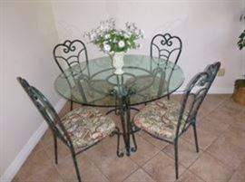 Beautiful metal and glass table with 4 chairs in excellent condition. Very good,quality.