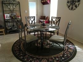 Round glass top table w/4 chairs; round rug