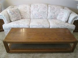 Sofa sleeper, pale, pastel floral upholstery.  MCM wood Coffee Table