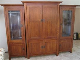 3-Piece Entertainment Unit with display and closed storage.  Will hold large TV.