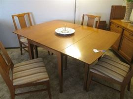 Drop-leaf style MCM Dining Table/4 Chairs, woven detailing on chair backs.  Leaves and Pads