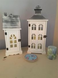 Two of several wooden houses that have battery operated lights