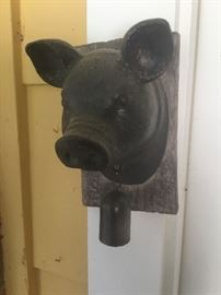 A cast iron pig with Bell by the side door