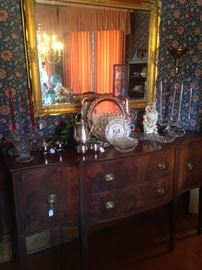 Impressive antique buffet with plenty of storage; large mirror; lovely glassware