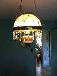Victorian hand painted parlor kerosine hanging lamp, has been converted to electric.