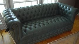 green leather sofa, matching chair/ottoman also