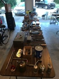 files, oil guns, wrenches, screwdrivers