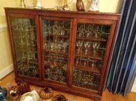 antique cabinet with glassware and crystal