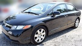 At 8PM: 2008 Honda Civic LX Sedan with 69,899 Miles; Black Exterior, Light-Gray Cloth Interior; Remote Keyless Entry Fob; Power Windows, Locks, Mirrors; ABS; AM/FM Stereo with CD ; Cruise Control; New Brakes; Current Inspection. VIN: 1HGFA165X8L066616