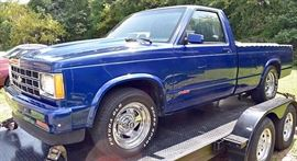At 8PM: 1983 Chevy S10 Pickup Truck. FULLY REBUILT with 350 Engine; Metallic-Blue Exterior with Ghost Flames; Gray Sport Cloth Interior; Automatic Transmission; Power Steering & Brakes; Dual Exhaust, and more.