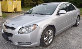 At 8PM: 2009 Chevy Malibu LT Sedan Estate Auto with 83,419 Miles; Silver Exterior, Black Sport Cloth Interior; Power Windows, Mirrors, Locks; Remote Keyless Entry Fob; Power Driver's Seat; AM/FM Stereo with CD, and more. VIN: 1G1ZH57B39F247908