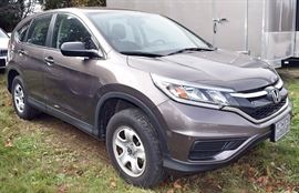 At 8PM: 2015 Honda CRV Estate Auto with only 13,570 Miles; AWD; Copper-Gray Metallic Exterior, Black Sport Cloth Interior; Power Windows, Locks, Mirrors; Remote Keyless Entry Fob; ABS and Honda ECON Mode; AM/FM Stereo with CD & AUX; 12V Power Outlet in Center Console; Hands Free Phone Connectivity with Speech Recognition; Steering Wheel Controls for Radio, Cruise, Communications, and much more. VIN: 2HKRM4H31FH685025
