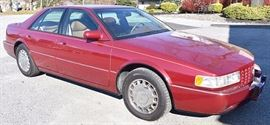 At 8PM: 1994 Cadillac Seville STS with 32V NorthStar Engine; Red Metallic Exterior, with Brown Leather Interior; Power Windows, Locks, Mirrors, Seats; Heated Front Seats; Power Moonroof; Remote Keyless Entry; AM/FM Stereo with CD and Cassette; ABS; In-car Telephone; New Tires; New Battery; Garage Kept and Showroom clean!; Odometer: 24,744. VIN: 1G6KY5297RU839128.