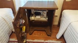 Sewing machine and cabinet $50