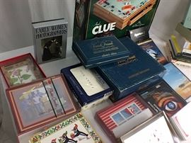 Cards for all occasions, 2 white shades, 2 cream shades, Monopoly & Clue wood game cabinet, Books, Trivial Pursuit and nature DVD's.