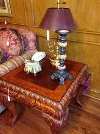 The end table matches the coffee table with its intricate carving.